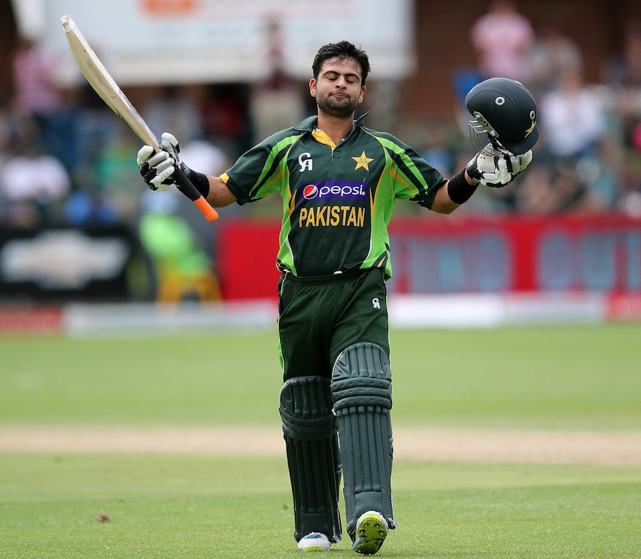 Pakistan's  Ahmed Shahzad celebrates his 100 runs on November 27, 2013 during the second One Day International (ODI) cricket match against South Africa at the St Georges Cricket Ground in Port Elizabeth.                       AFP PHOTO / ANESH DEBIKY        (Photo credit should read ANESH DEBIKY/AFP/Getty Images)