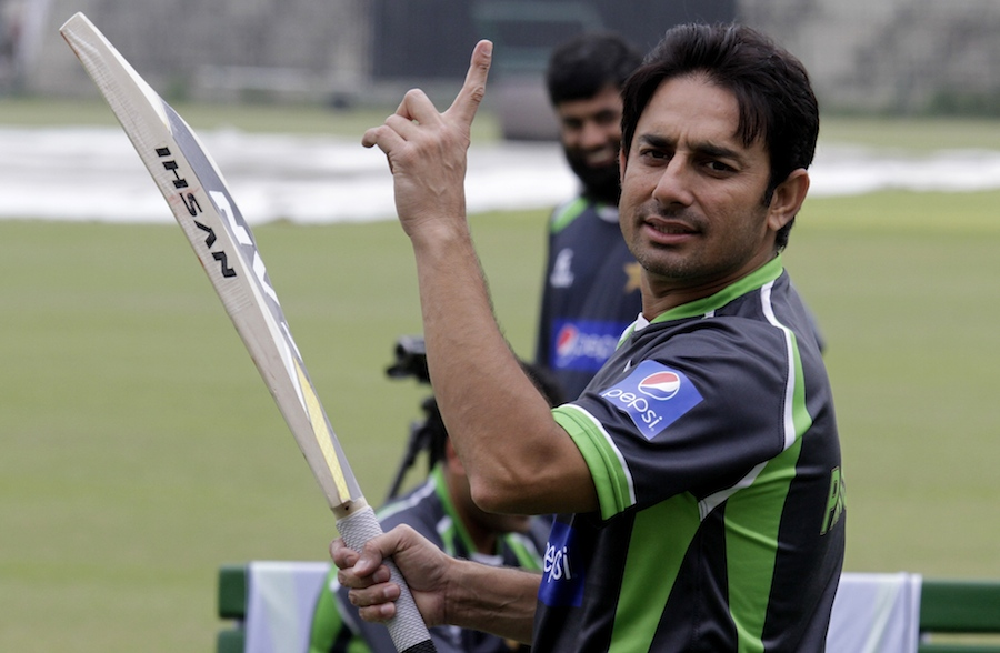 Newly inducted cricketer Saeed Ajmal holds up a finger during a practice session in Lahore, Pakistan, Tuesday, April 7, 2015. Pakistan's cricket team is due to arrive in Bangladesh next Monday for three ODIs, a Twenty20 match and two test matches. (AP Photo/K.M. Chaudary)